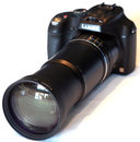 "Panasonic Lumix FZ70 FZ72 With Teleconvertor (2) | <a target=""_blank"" href=""https://www.magezinepublishing.com/equipment/images/equipment/Lumix-FZ72-5229/highres/Panasonic-Lumix-FZ70-FZ72-with-Teleconvertor-2_1375354706.jpg"">High-Res</a>"