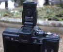 "Panasonic LVF2 tilted on camera | <a target=""_blank"" href=""https://www.magezinepublishing.com/equipment/images/equipment/Lumix-GX1-3655/highres/panasoniclumixlvf2oncamera_1320338241.jpg"">High-Res</a>"