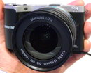 "Samsung Nx210 Silver (1) | <a target=""_blank"" href=""https://www.magezinepublishing.com/equipment/images/equipment/NX210-4113/highres/samsung-nx210-silver-1_1346687549.jpg"">High-Res</a>"