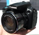 "Canon PowerShot SX50 HS | <a target=""_blank"" href=""https://www.magezinepublishing.com/equipment/images/equipment/PowerShot-SX50-HS-4831/highres/canon-powershot-sx50-2JPG_1348229129.jpg"">High-Res</a>"