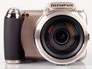 "Olympus SP-810UZ Front | <a target=""_blank"" href=""https://www.magezinepublishing.com/equipment/images/equipment/SP810UZ-Ultra-Zoom-3519/highres/olympussp810uzfront_1331112707.jpg"">High-Res</a>"